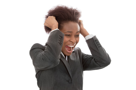 pulling hair: Business  frustrated black woman pulling out hair screaming isolated on white background - crying