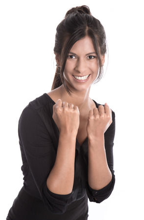 robustness: Successful young business woman smiling in a black dress - power and strength Stock Photo