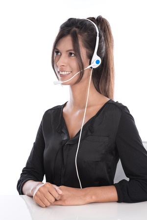 callcenter: Woman in a call center - support operator with a headset, isolated on white background