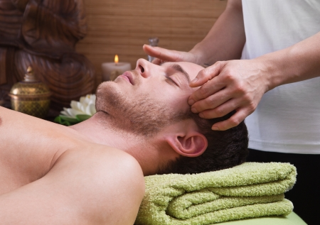massage: Hands of woman making massage - man at spa - time for relax