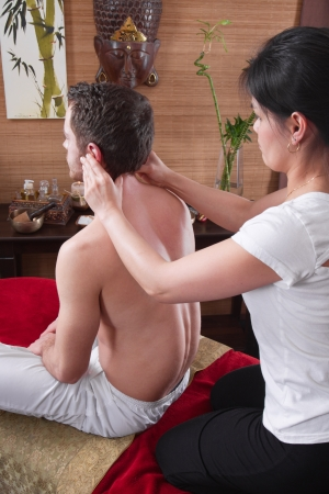 Hands of woman making massage - man at spa - time for relax photo