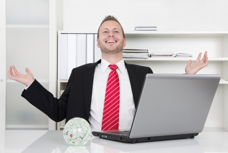 Successful businessman laughing with hands up and laptop - perfect day photo
