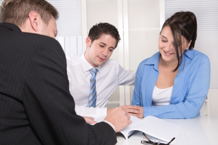 tax consultants: Young couple in a meeting - insurance or bank for investments Stock Photo