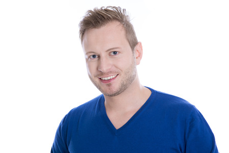 Young blonde man with stubble in blue top looking at camera isolated on white background with a blue pullover Stock Photo
