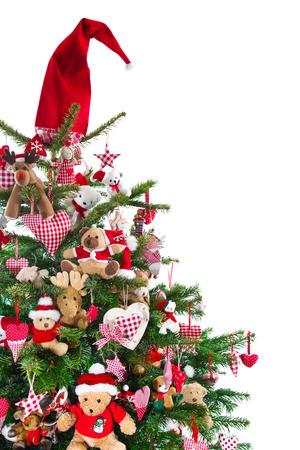 stile country: Coloritamente decorato isolato albero di Natale con decorazioni rosse - tradizionale in rosso e verde con oggetti a scacchi in stile Country Archivio Fotografico