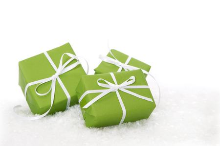 three gift boxes: Three green gift boxes tied with white ribbon - present isolated for christmas or birthday or idea for a christmas card