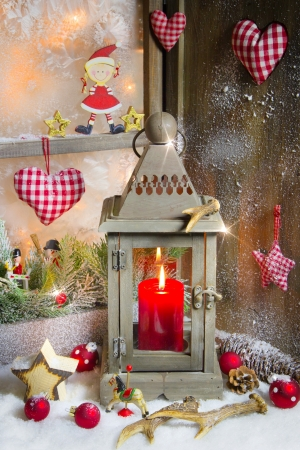 Country Style - christmas decoration with wood, candle and red checkered heart