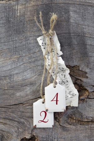 24 month old: Top view of  music sheet and 24 for christmas on wooden background - country style Stock Photo