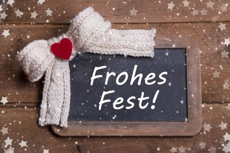 stile country: Biglietto di auguri per Natale con un cuore rosso e il testo tedesco stile country