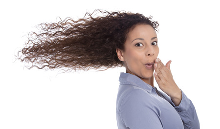 forgetfulness: Windy   surprised woman with blowing hair in wind isolated on white background - funny eye catcher - woman have stress