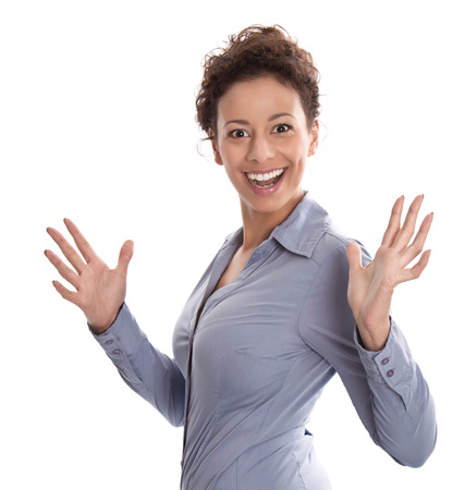 Successful businesswoman in blue turning towards camera with hand gesture isolated on white background - success or perfect day photo