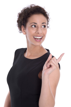 Business: smiley pretty woman in black looking back over shoulder and pointing isolated on white background  photo