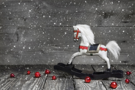 shabby chic background: Old wooden horse - shabby chic or country style Christmas decoration - background for a greeting card