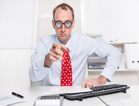 Warning: Angry businessman with a red tie showing with his index finger - looking aggressive and arrogant. Stock Photo