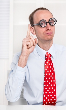 finger tip: Smart young businessman like a comedian or an officials give an advice or tip for saving money or inform somebody about news. Stock Photo