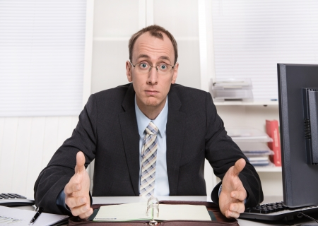examiner: Typical examiner or controller - arrogant and disagreeable sitting at desk with computer
