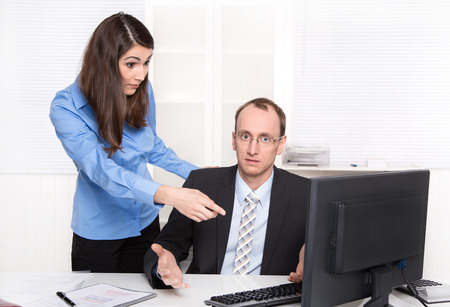 misunderstanding: Misunderstanding under men and woman - businessman have a discussion with a female colleague - differences. Stock Photo