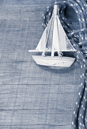 lashing: Sailing boat on wood as a postcard