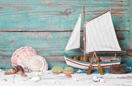 Sailboat or fishing boat made of wood as nautical decoration on wooden background Stock Photo