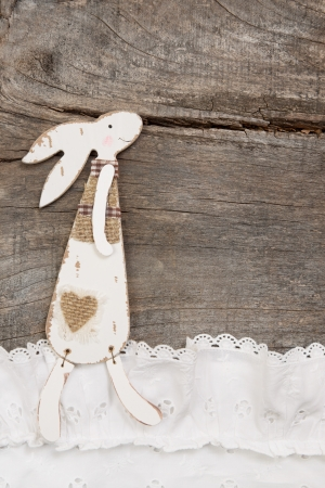 Rabbit on a brown wooden background for easter decoration - greeting card.  photo
