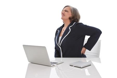 Elderly business woman - female has backache in the office Stock Photo - 23796464