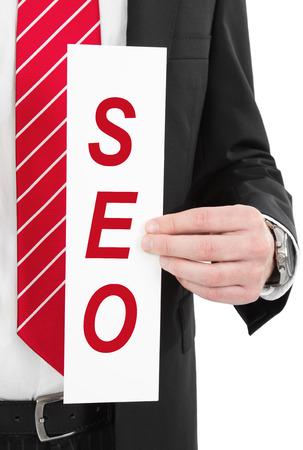 tweak: Man with sign in hand SEO Stock Photo