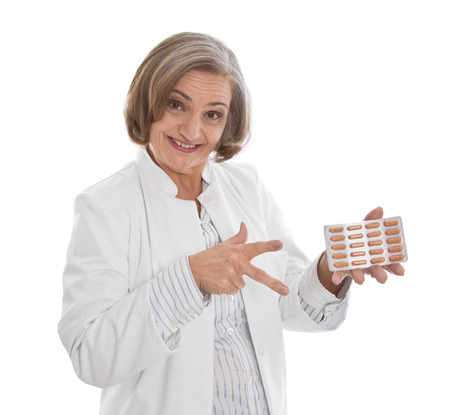 pharmaceutic:  Doctor prescribes pills - isolated in white doctors coat