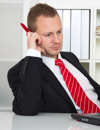 overburdened: Employee with no desire to work. Lazy businessman on workplace