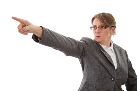 aggressive people: Woman upset and angry pointing away, isolated on white