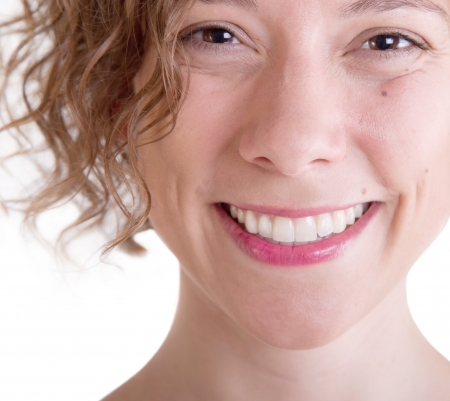 A bright natural pretty smile of a beautiful woman Stock Photo - 23796952