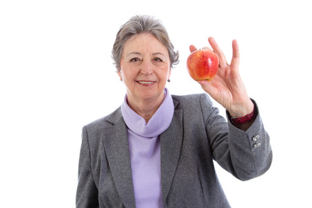 Elderly woman holding apple in her hand Stock Photo - 23827156