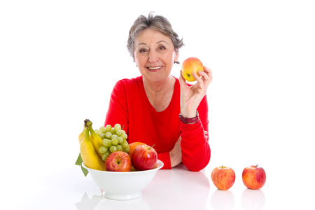 Fruit - healthy diet in old age. Elderly woman with fruits Stock Photo - 23827158