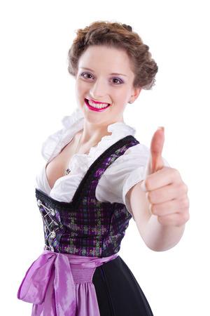 Bavarian girl is looking forward to the Oktoberfest. Beautiful woman thumbs up