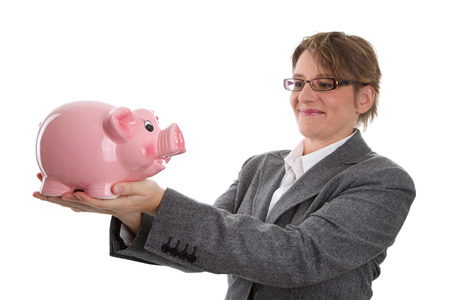 recompense: Mid adult business woman with her savings in piggy bank isolated on white Stock Photo