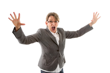 releasing: Crazy business woman hands up and screaming, isolated on white