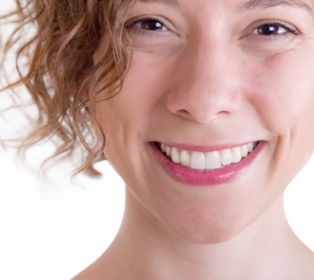 A bright natural pretty smile of a beautiful woman Stock Photo - 23797364