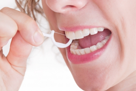 care about the health: Dental care with dental floss. Woman care about her teeth