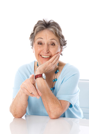 womanhood: Humorous older lady pointing with finger at camera