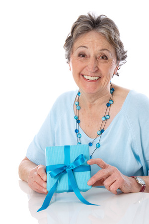 70 75: Grandmother isolated on Mothers Day with gift