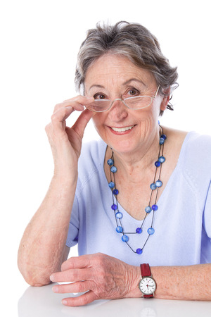 womanhood: Happy senior lady with glasses isolated  Stock Photo