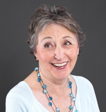 Humorous elderly woman with gray hair laughing Stock Photo - 23797479
