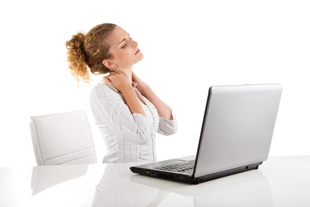 Young woman has pain in the neck with laptop Stock Photo - 23797483