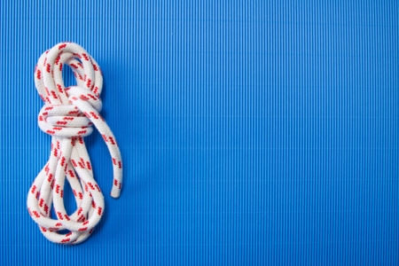 Rope as a nautical decoration or background in blue photo