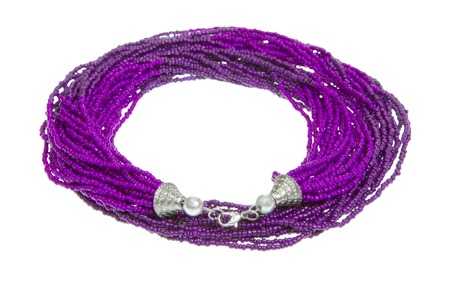 Purple necklace on white background - jewelery. photo