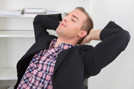 lunchbreak: Man dreams to himself in office with closed eyes