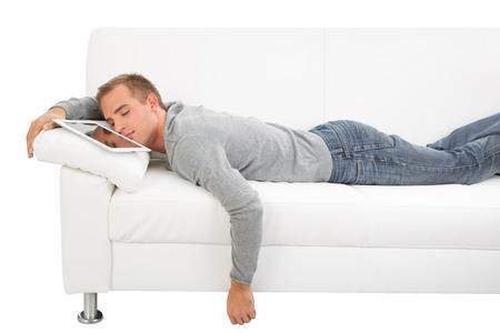 sleeping tablets: Overstimulation Internet. Tired man sleep on sofa with tablet PC