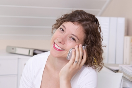 Business woman with the Smartphone at workplace Stock Photo - 23837019