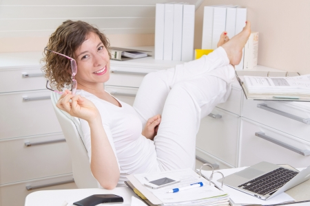 Woman relaxing in office Stock Photo - 23837022