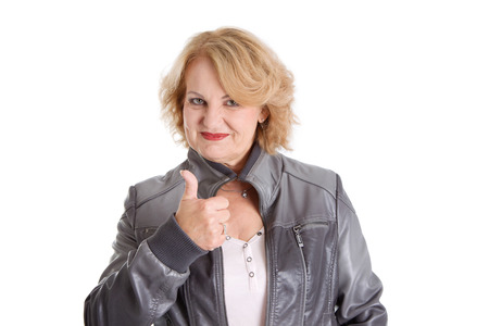 finally: Finally retired! Mature woman thumbs up, isolated on white