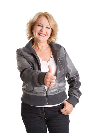Mature smiling woman thumbs up, isolated on white photo